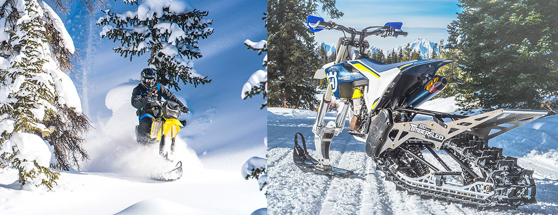 yellow bike with a timbersled going down a snow mountain