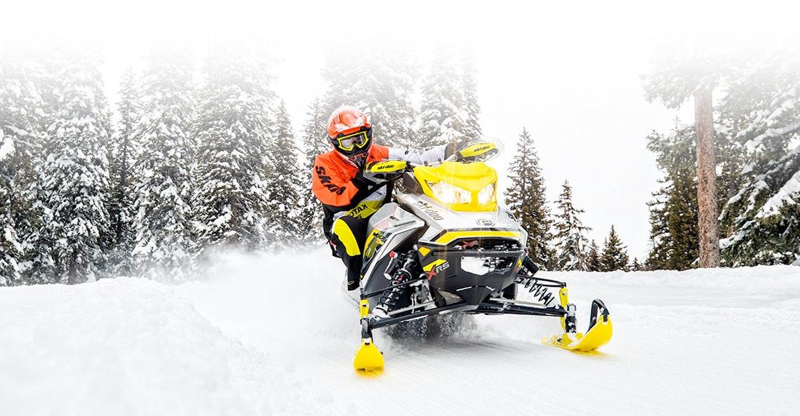 yellow Ski-Doo® MXZ®  on snow