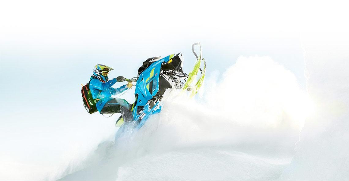 blue Ski-Doo® Summit on snow mountain