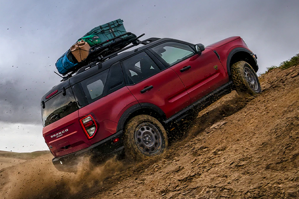 A 2021 Ford Bronco Sport being driven off road in the desert