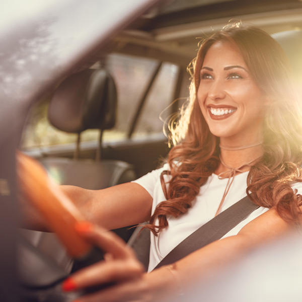 Woman happily driving car