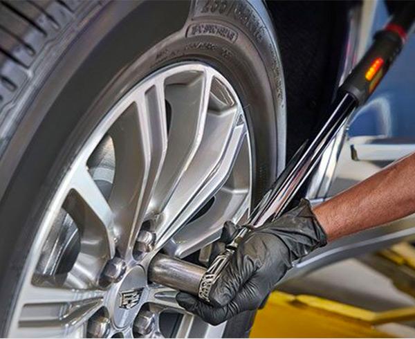 Mechanic working on Cadillac tire